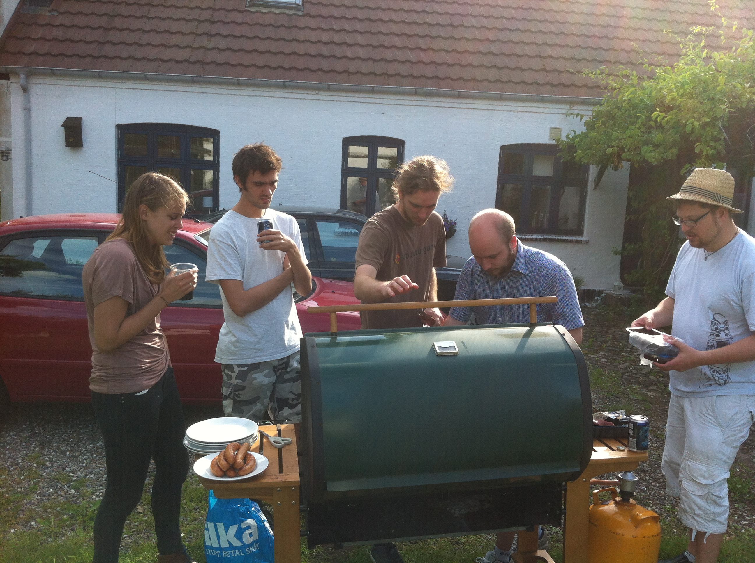 People gathering around the grill